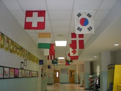 Flags in the school hallway represet countries of students' heritage